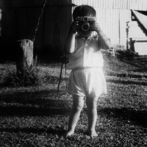 Vincent holding a camera for the first time, age 3.